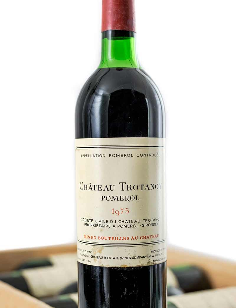 Lot 581-582: parcels of 12 bottles 1975 Chateau Trotanoy in OWC