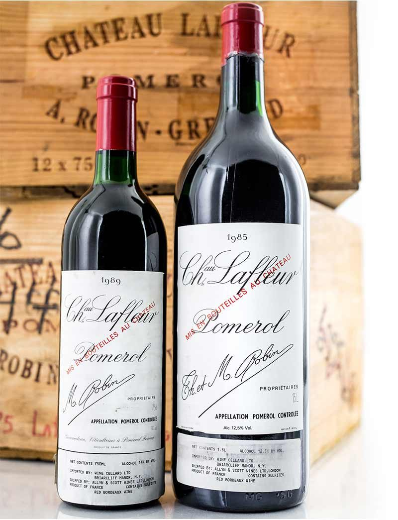 Lot 889, 890: 6 magnums 1985 and 12 bottles 1989 Chateau Lafleur in OWC